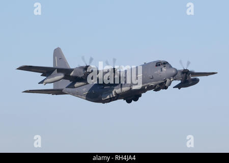 A USAF MC-130J Hercules from the 352nd SOW climbs out of RAF Mildenhall on a freezing morning. - Stock Image