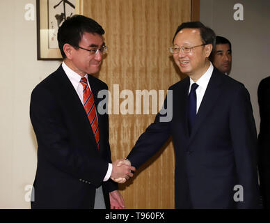 Tokyo, Japan. 17th May, 2019. Chinese top diplomat and Political Bureau member Yang Jiechi (R) shakes hands with Japanese Foreign Minister Taro Kono prior to their talks at Kono's office in Tokyo on Friday, May 17, 2019. Yang is now in Japan to hold talks with Japanese officials as Chinese President Xi Jinping will visit Japan for the G20 summit meeting in Osaka next month. Credit: Yoshio Tsunoda/AFLO/Alamy Live News - Stock Image
