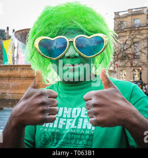 London, UK. 17th Mar, 2019.  A reveller on the square. Following the spectacular St Patrick's Day Parade earlier, people celebrate and watch performances on Trafalgar Square in the heart of London. Credit: Imageplotter/Alamy Live News - Stock Image