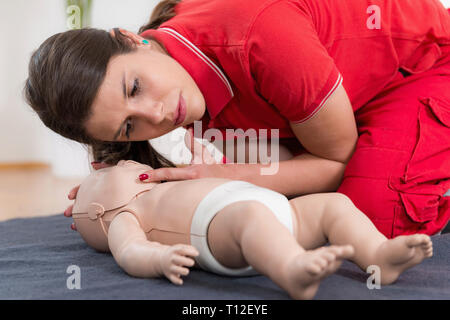 First Aid Training. Cardiopulmonary resuscitation. First aid course on baby dummy. - Stock Image