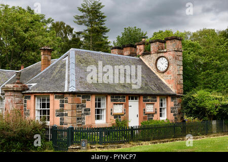 West Clock Lodge in Sheriffmoor Plantation Forest at Eagle Lodge Scottish Borders Scotland UK station house with clock on chimney - Stock Image