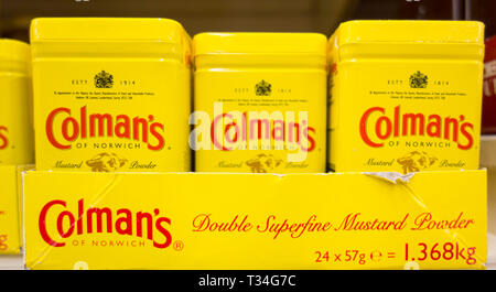 Coleman's Mustard containers on a supermarket shelf in the UK - Stock Image