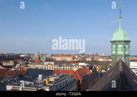 Skyline and rooftops of Copenhagen, Denmark. Trinitatis Church tower, Rosenborg Palace and King's Garden. New district Nordhavn in the distance. - Stock Image