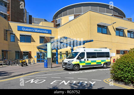 Exterior of Queens Hospital pfi building maternity healthcare ward entrance with G4S ambulance transport vehicle Romford East London England UK - Stock Image
