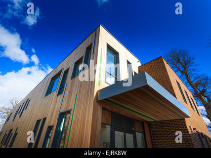 Modern timber clad college building - Stock Image