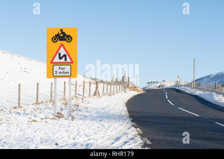 Dangerous bends road sign on the A93 (Old Military Road) in The Cairngorms leading up to Glenshee Ski Centre, Scotland, UK - Stock Image