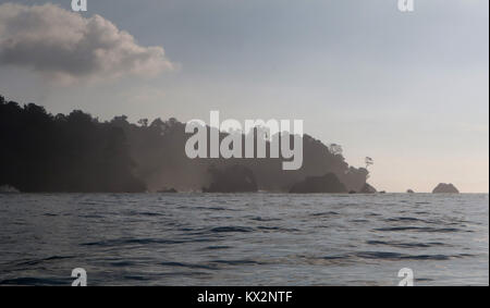 Boat with tourist jumping waves view from ocean Corcovado national Park Osa Peninsula Costa Rica - Stock Image