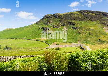 Cat Bells (451 metres) south western approach with the path from Littletown rising on the steepening slope. - Stock Image