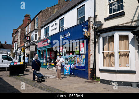 Martins supermarket and Ladbrokes betting shop Market Place Thirsk North Yorkshire England UK United Kingdom GB Great Britain - Stock Image