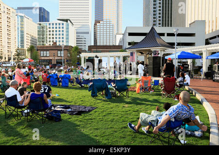 Charlotte, North Carolina. People attending a music event in the Romare Bearden Park in downtown. - Stock Image