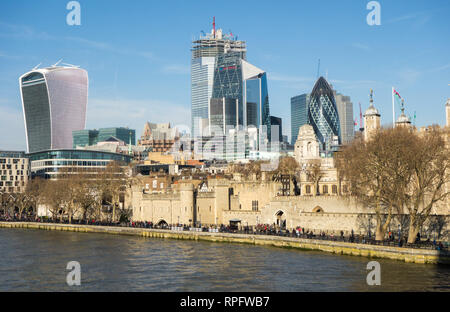 London skyline across the river Thames towards the city of London with its many modern new buildings and offices and the tower of London - Stock Image