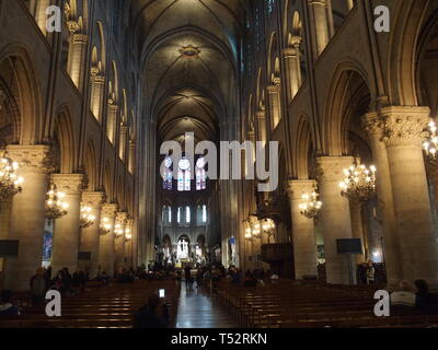 PARIS, FRANCE on April 2015: Interior of main nave at Notre-Dame cathedral, Our Lady of Paris in european capital city. - Stock Image