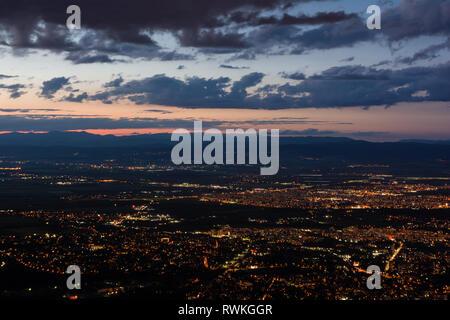 View to the Sofia city at dusk. View from the Kopitoto Hill, Vitosha Mountain, Bulgaria. - Stock Image