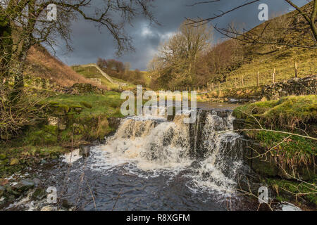 North Pennines AONB landscape, Ettersgill Beck Waterfall in dramatic light Dec 2018 - Stock Image