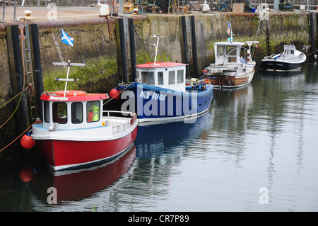Fishing boats in the harbour of the Fife fishing port of St Monans - Stock Image