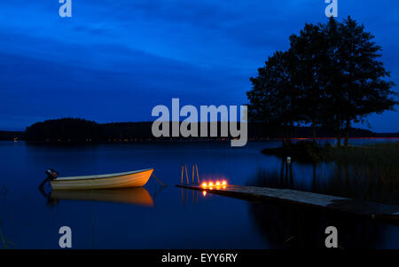 Boat at jetty - Stock Image