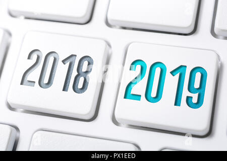 Macro Of 2 Buttons With The Year 2018 And 2019 On White Keyboard - Stock Image