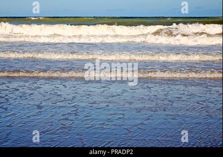 Waves breaking on the shore on the North Norfolk coast at East Runton, Norfolk, England, United Kingdom, Europe. - Stock Image