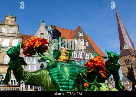 A man in a floral costume enjoys the annual Bremen Samba Carnival celebrations, Germany, Europe - Stock Image