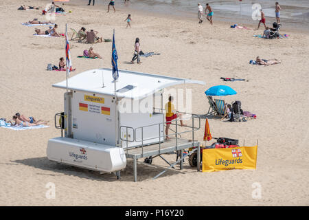 Bournemouth, UK. 11th June 2018. RNLI lifeguards watch over tourists enjoying the hot and sunny weather on Bournemouth beach and seafront. Credit: Thomas Faull/Alamy Live News - Stock Image
