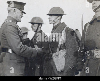 General John J. Pershing, Commander in Chief, A.E.F., decorating men of 27th. Division. Headquarters, Second Army Corps. Belgian Camp, Bonnetable, Sarthe, France ca. 1/22/1919 - Stock Image