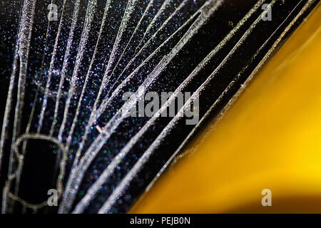 A macro view of the patterns left by the adhesive layer on a piece of sticky tape. - Stock Image