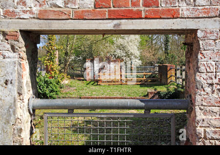 A view along the lower section remains of the former watermill over the River Bure at Horstead, Norfolk, England, United Kingdom, Europe. - Stock Image