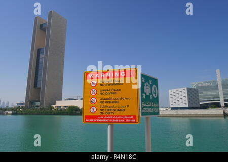 No swimming, no diving, no fishing, no lifeguard on duty, assembly point, Four Seasons Hotel, Arcapita, East Park Mosque behind, Bahrain Bay, Bahrain - Stock Image