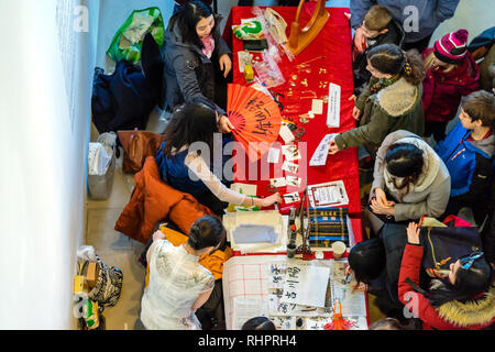 People attending a Chinese calligraphy workshop - Stock Image