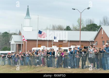 Residents show their support for U.S President Donald Trump and First Lady Melania Trump as they visit the tornado damaged region March 8, 2019 in Lee County, Alabama. The region was hit by a tornado on March 3rd killing 23 people. - Stock Image