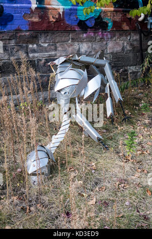 Insect sculpture by Moses Kofi along Agusta St. in Kensington Market in downtown Toronto, Ontario, Canada - Stock Image