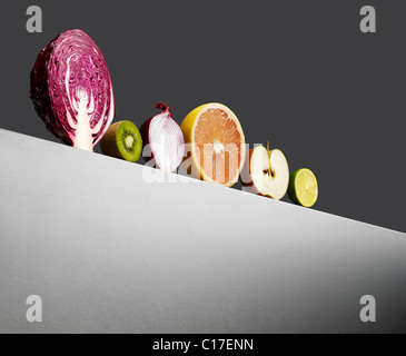 Row of assorted fruir and vegetables on a horizon. - Stock Image