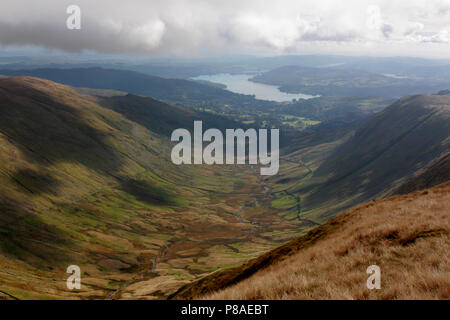 In the Lake District looking south towards Rydal Valley and Windermere from Great Rigg, with High Pike and Low Pike hills at left - Stock Image