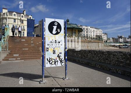 Graffiti on Brighton seafront council information board - Stock Image