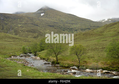 The rocky upper reaches of the Water of Nevis in Glen Nevis - Stock Image