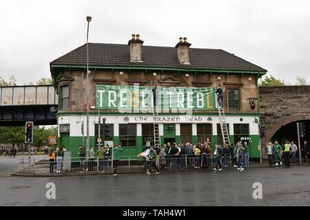 25th May, 2019. Glasgow, Scotland, UK, Europe. Scottish Cup winners, Celtic Football Club fans celebrate their achievement of three consecutive seasons of domestic trophies. The first time a domestic club has completed the triple treble in world football.The Brazen Head pub, a favourite bar for Celtic fans errected a large banner to celebrate the achievement soon after the game ended. - Stock Image