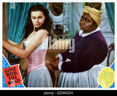 """Tighter, Mammy! Mr Butler will be at the ball! I must be beautiful!"" Scarlett O'Hara (Vivien Leigh) and her - Stock Image"