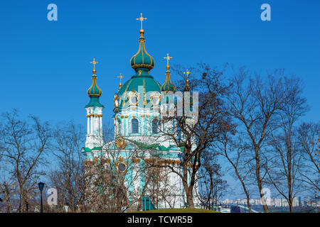 View from the park to St. Andrew s Church. The beautiful baroque St. Andrew s church was built in Kiev between 1747 and 1754 according to the design o - Stock Image