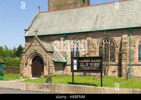 Sign and entrance porch to St. Katharine's church, Blackrod near Bolton, Lancashire. Note the less common spelling - Stock Image