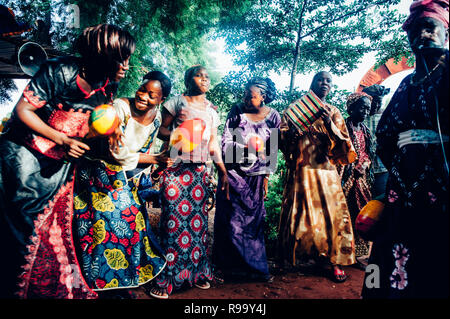 Group of black women singing and dancing. Multi Ethnic music party to celebrate western and developing countries cooperation. Bamako, Mali. Africa - Stock Image