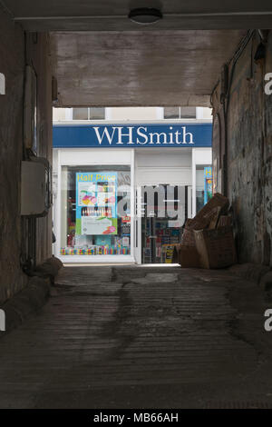 Death of the High Street metaphor / concept - WHSmith Bodmin (Cornwall) seen through archway opposite the shop. High Street crisis. - Stock Image
