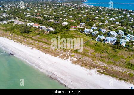 Sanibel Island Florida Gulf of Mexico beach East Gulf Drive homes Colony Beach Estates Kinzie Sanibel Causeway Bridge aerial overhead bird's eye view - Stock Image