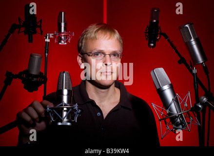 A music and sound designer in his studio in Fayetteville, Arkansas, U.S.A. - Stock Image