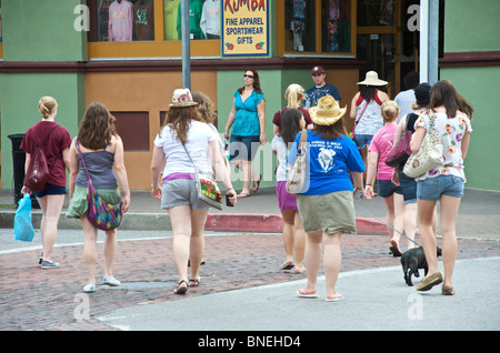 Overweighed ladies walking into store in USA - Stock Image
