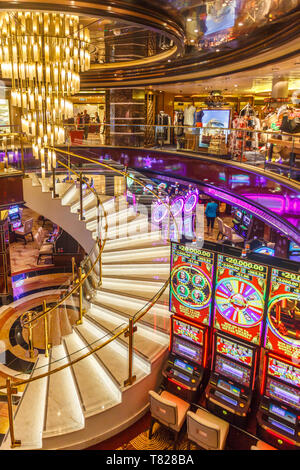 Civitavecchia, Italy - 20th September 2017: Staircase, shops and gaming machines in the Atrium on Royal Princess cruise ship. Most ships feature casin - Stock Image