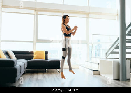 Adult Woman Training Legs Doing Squat and Jumping - Stock Image