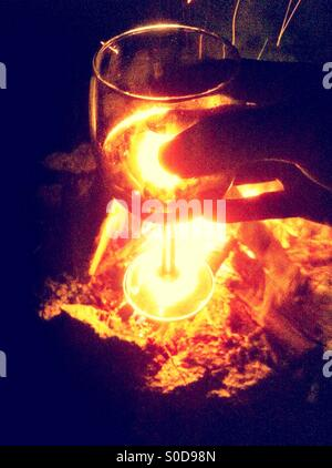 Wine glass and fire - Stock Image