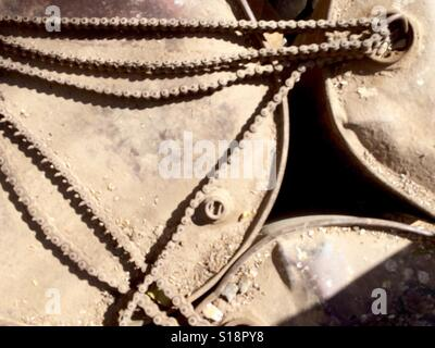 Oil drums tied with motorbike chains - Stock Image