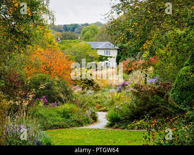Compressed perspective view over the Autumn hues of the Long Walk at The Garden House, Buckland Monachorum, Devon, UK - Stock Image