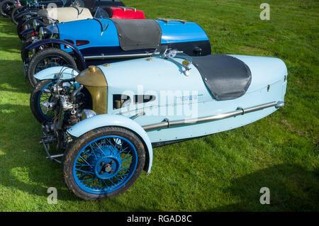 A row of classic vintage Morgan 3-wheeler sports cars at Prescott Hill Climb, Gloucestireshire - Stock Image